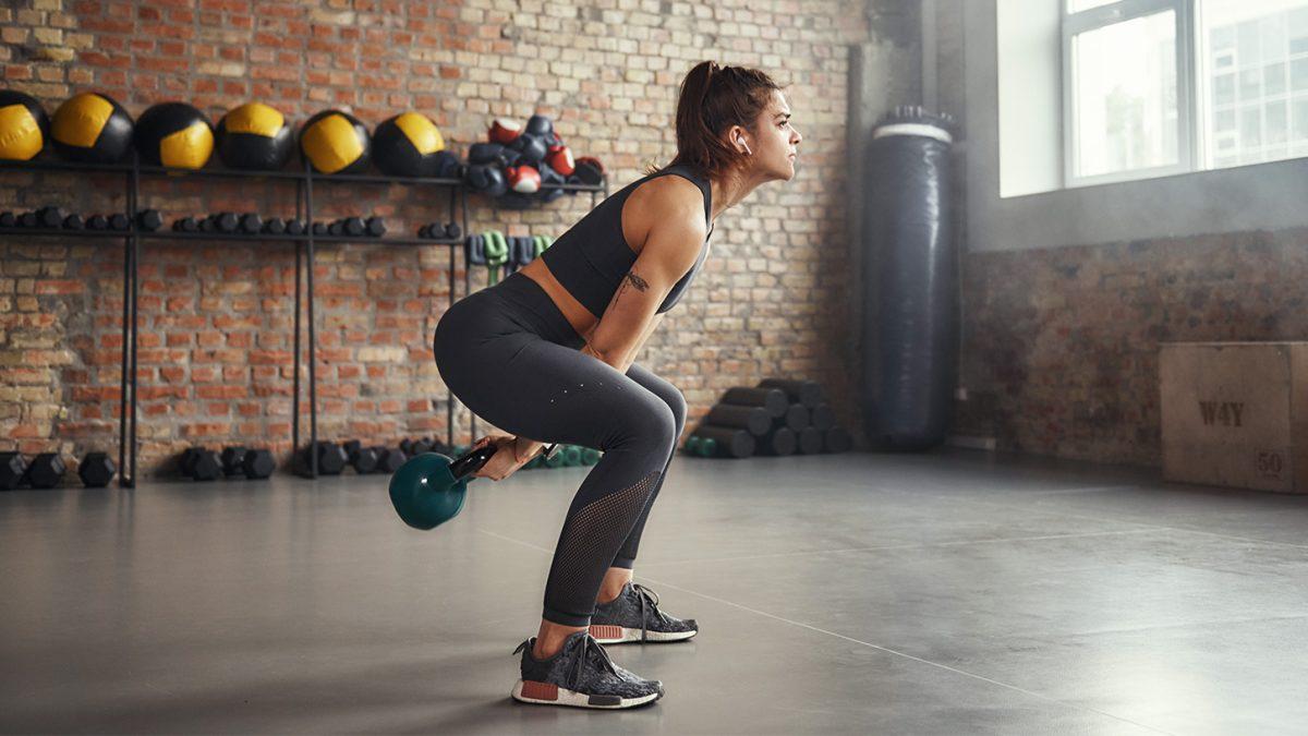 Woman kettlebell workout EVO Fitness
