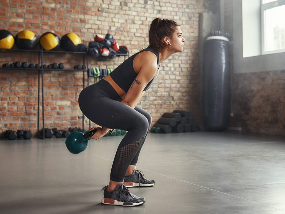 Woman kettlebell workout EVO Fitness
