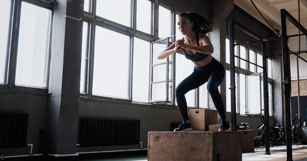woman box jump evo fitness